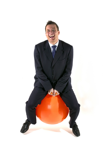 very happy man on a space hopper showing what a bounce rate is