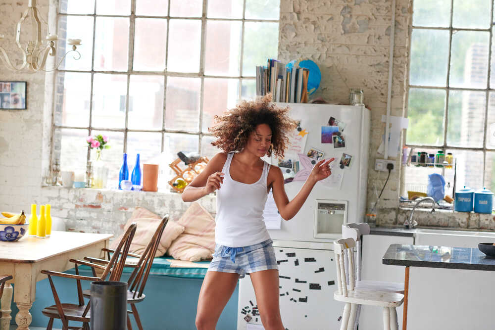 girl dancing in the kitchen
